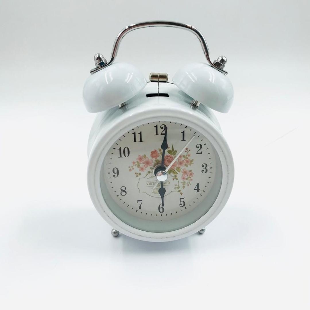 تصویر ساعت رومیزی کوچک زنگ دار